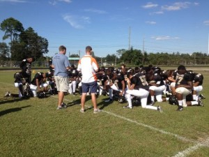 praying with football team